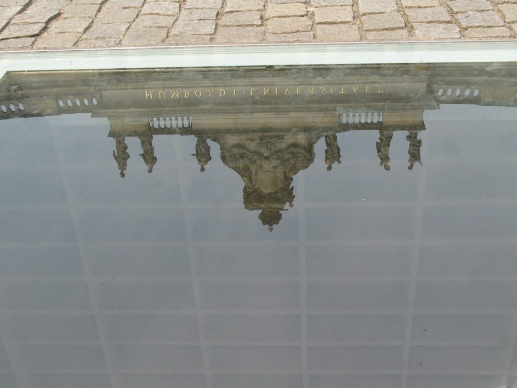 Image 2: Like Memorial, contemporary monuments often make use of conspicuous absences; here the subterranean set of empty shelves commemorating the Nazi book burning on Bebelplatz in Berlin. © Carolin Hahnemann